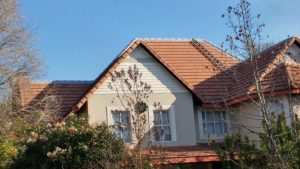 Waterproofing tiles on high pitch roof