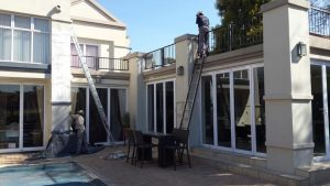 Damp-proofing and painting of a house
