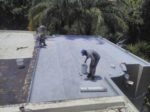 Waterproofing in progress on a concrete roof