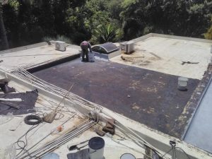 Removing damaged waterproofing on a concrete roof