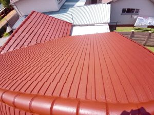 Roof repairs, waterproofing and painting of tile roof.